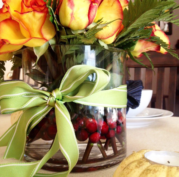Thanksgiving centerpiece with roses and cranberries
