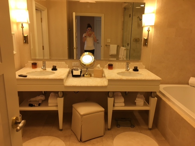 Wynn hotel Las Vegas bathroom vanity featured by top Boston travel blog, Feathers and Stripes
