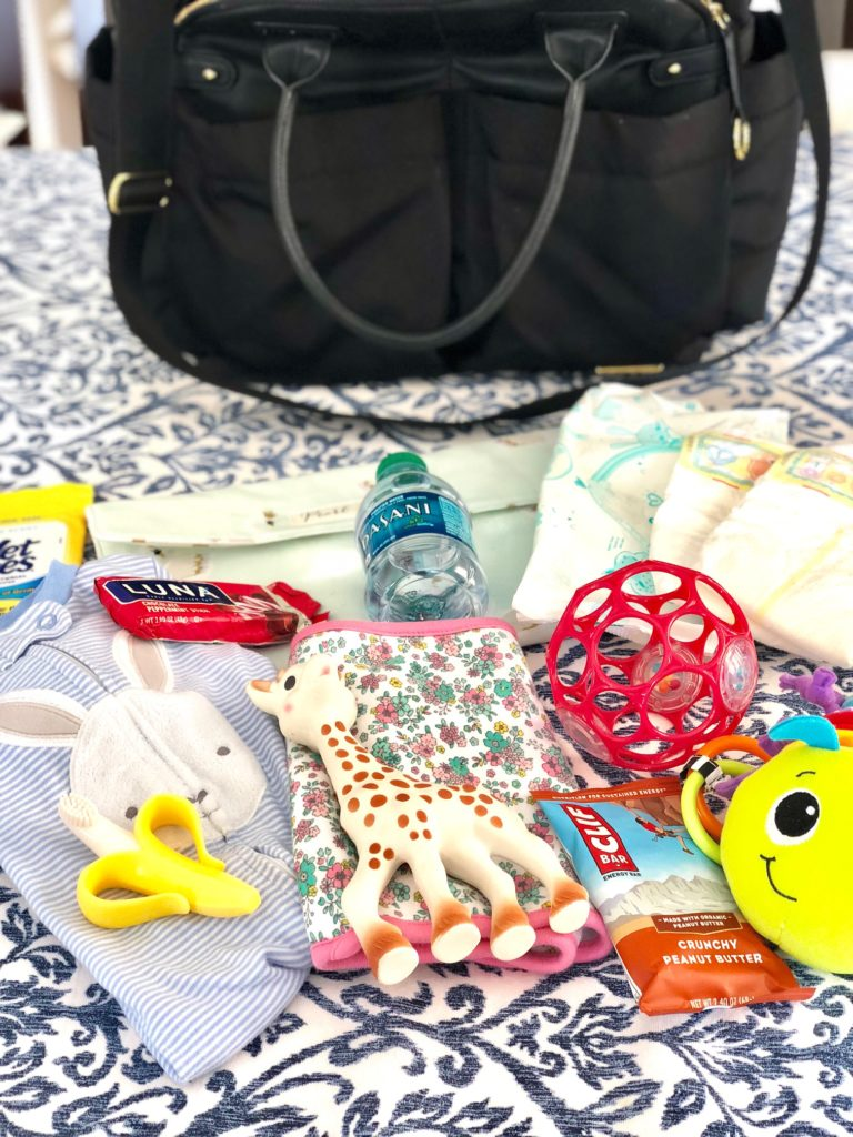 what to carry in your diaper bag for a 6 month old | Diaper Bag Essentials featured by popular Boston life and style blogger, Feathers and Stripes