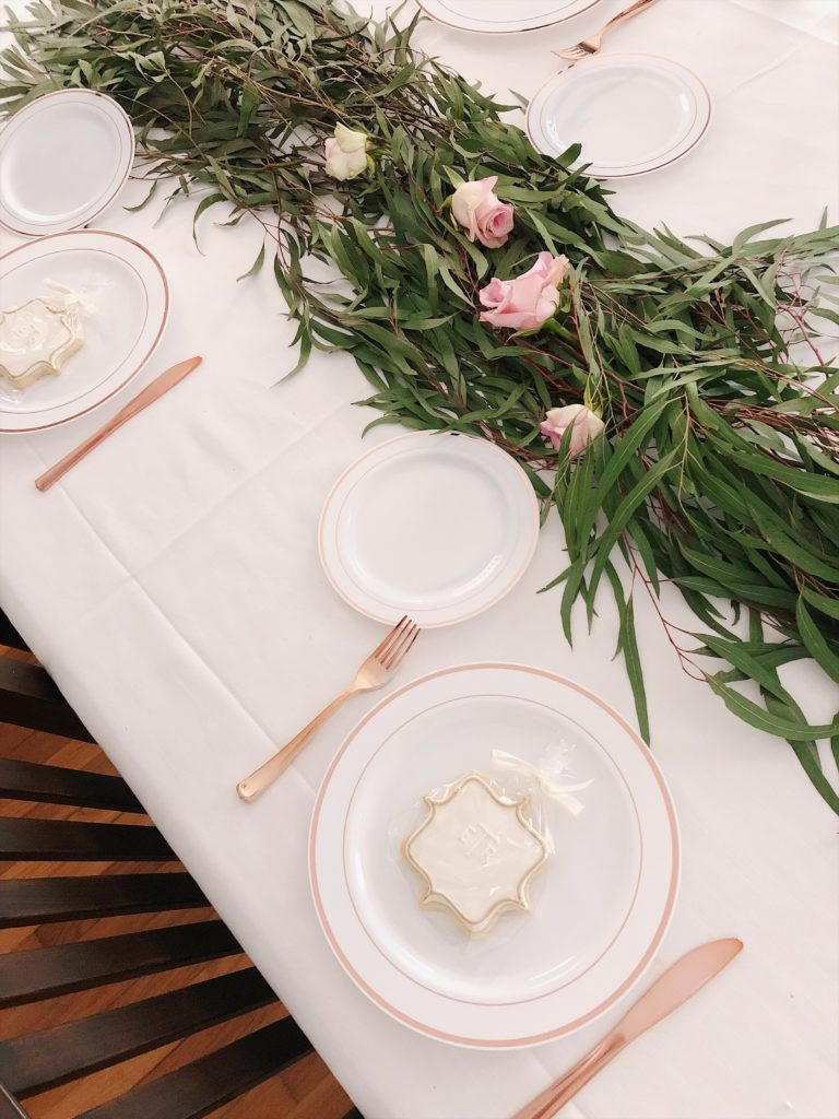 green floral DIY table runner with greens and roses