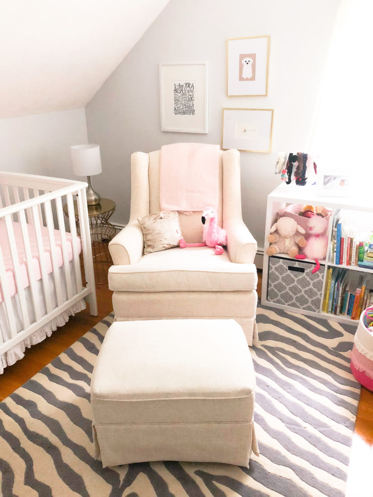 pink and gray baby girl nursery, small space nursery | Pink and Gray Nursery decor ideas featured by popular Boston life and style blogger, Feathers and Stripes