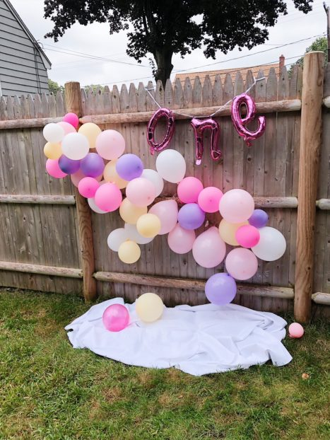 a picnic-inspired pink and purple and yellow first birthday party for baby girl