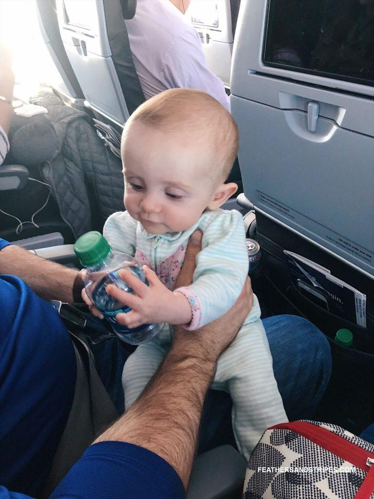 flying cross-country with a 6 month old baby from mom and travel blogger Alyssa from feathersandstripes.com
