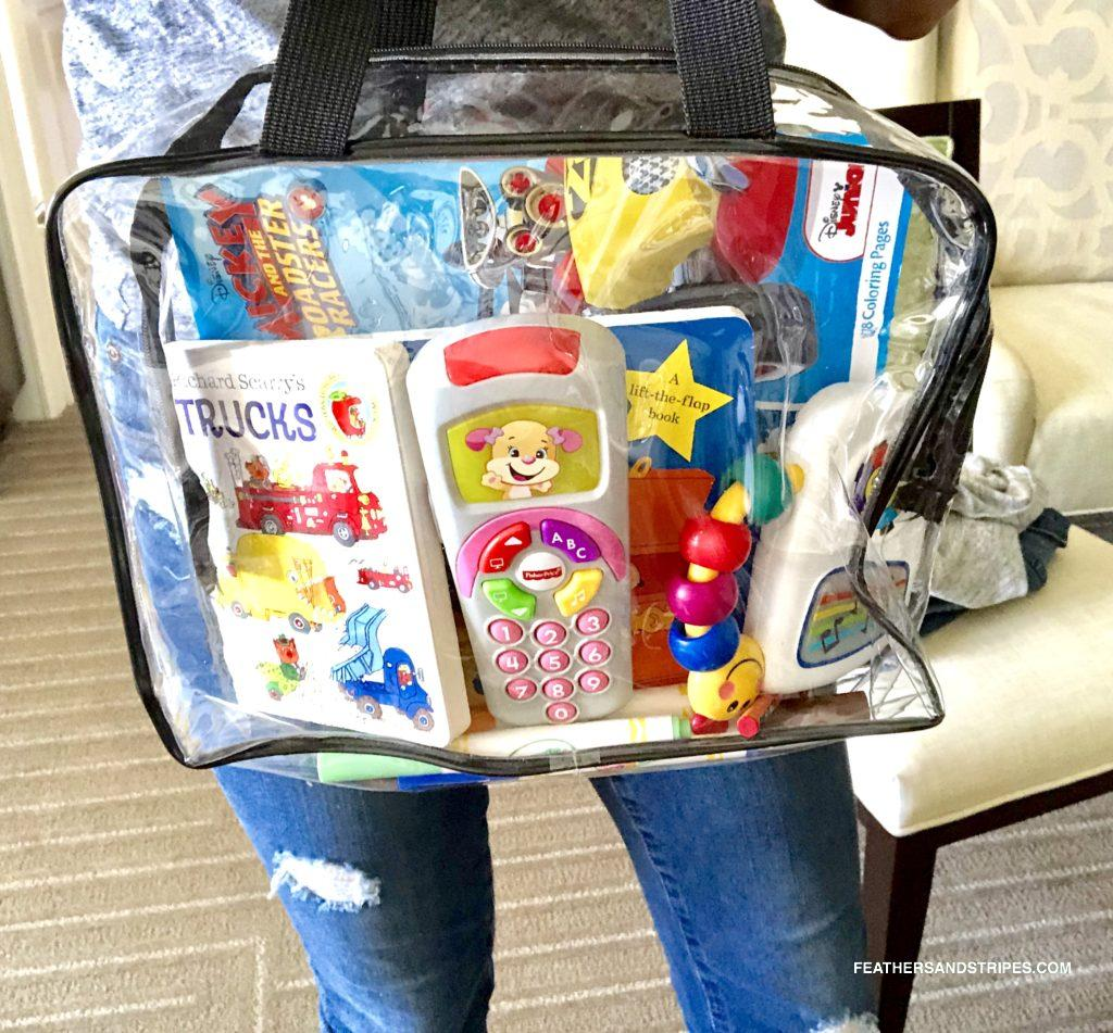 activity bag for traveling with a toddler - perfect for flying with a toddler! feathersandstripes.com