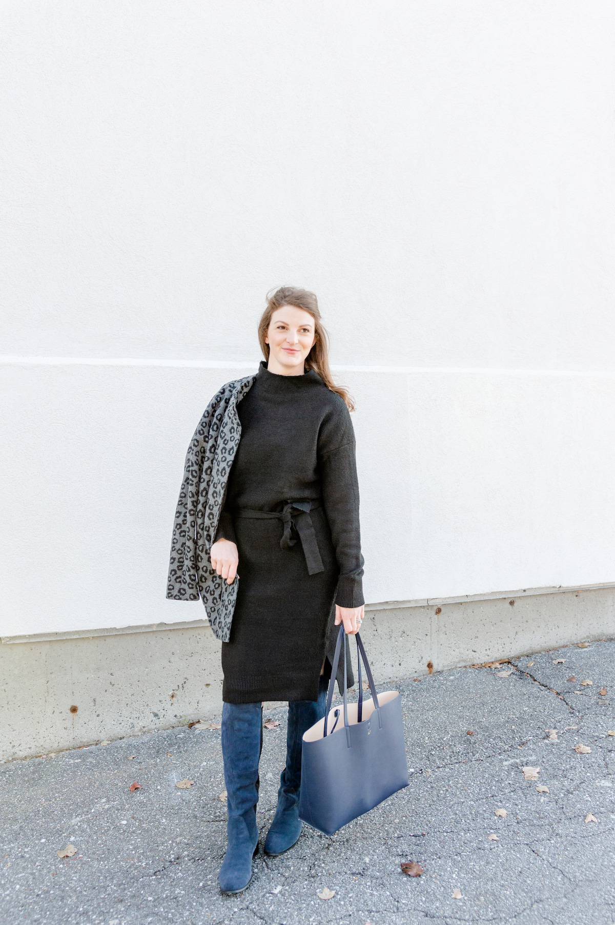How to wear a black sweater dress with OTK boots - comfy and classic for a holiday get-together