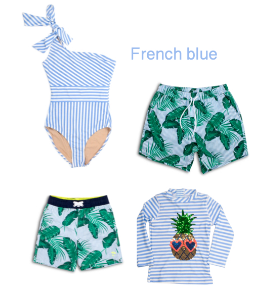 family matching swimsuits in french blue stripes and palm leaves